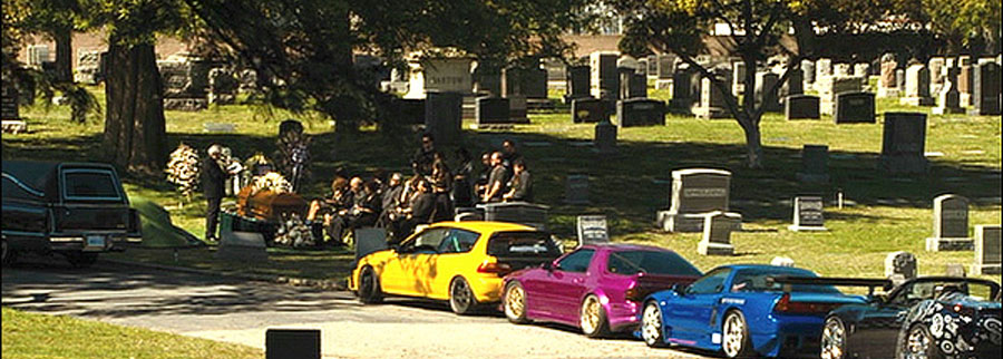 burial-with-colourful-cars